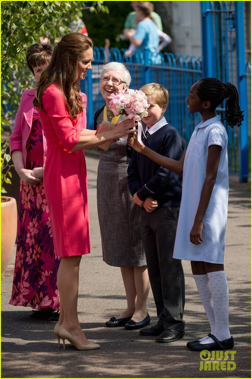 kate middleton is bright in pink for blessed sacrament school visit 06