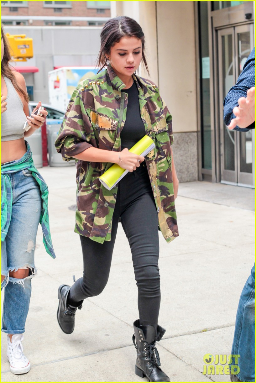selena gomez covers up camo jacket 133153062