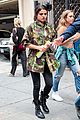selena gomez covers up camo jacket 07