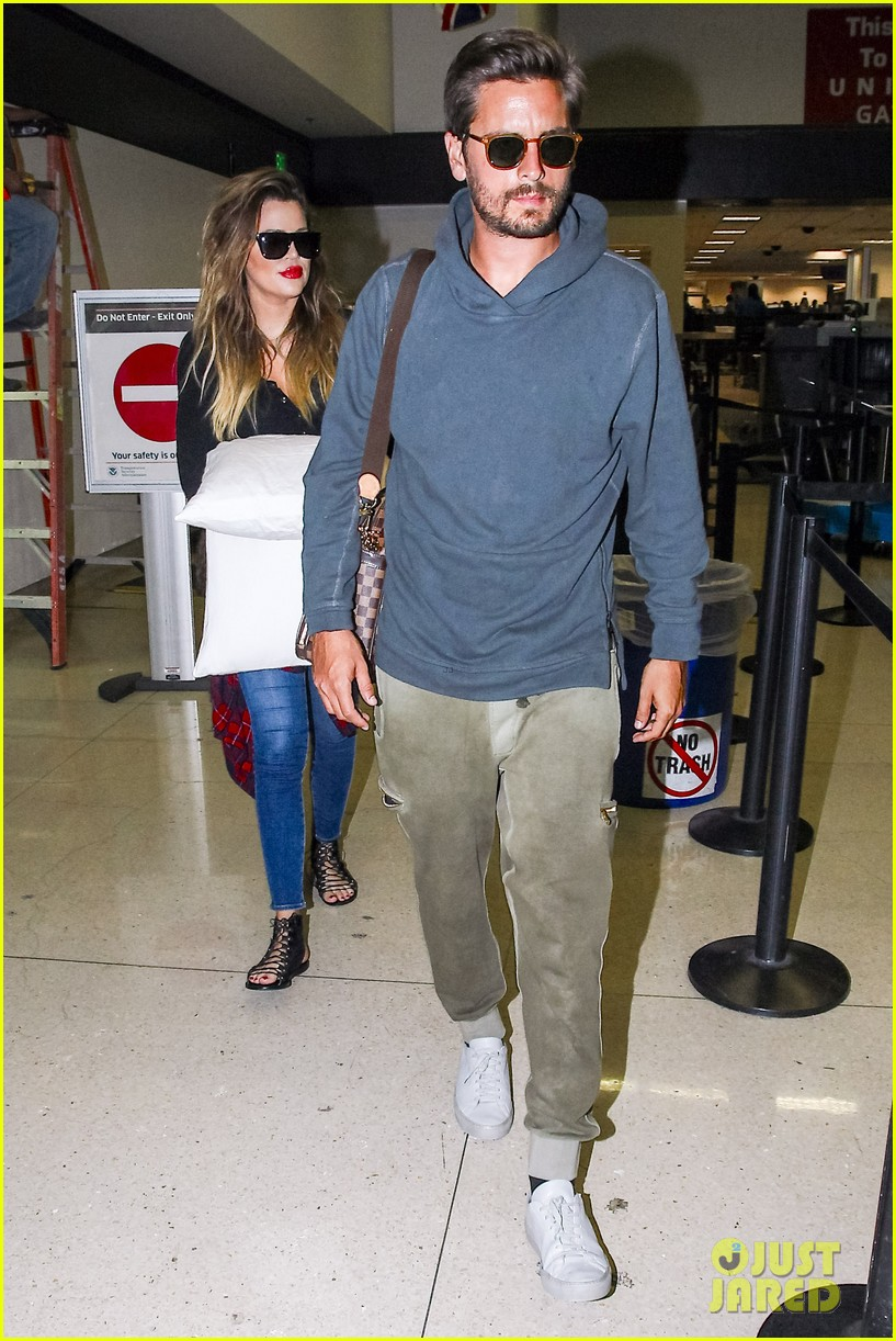 khloe kardashian touches down at lax with scott disick after hosting together 03