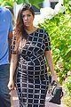 kim kardashian shows midriff in sexy dress at dinner 20