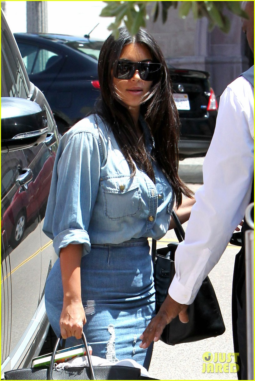 kim kardashian does double denim lots of cleavage on family outing 063181029