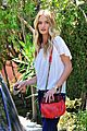 rosie huntington whiteley stuns lacy dress modelco launch 09