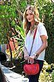 rosie huntington whiteley stuns lacy dress modelco launch 10