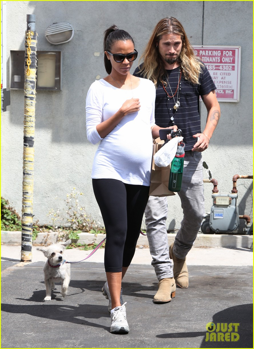 zoe saldana preps for baby at moms the word 14