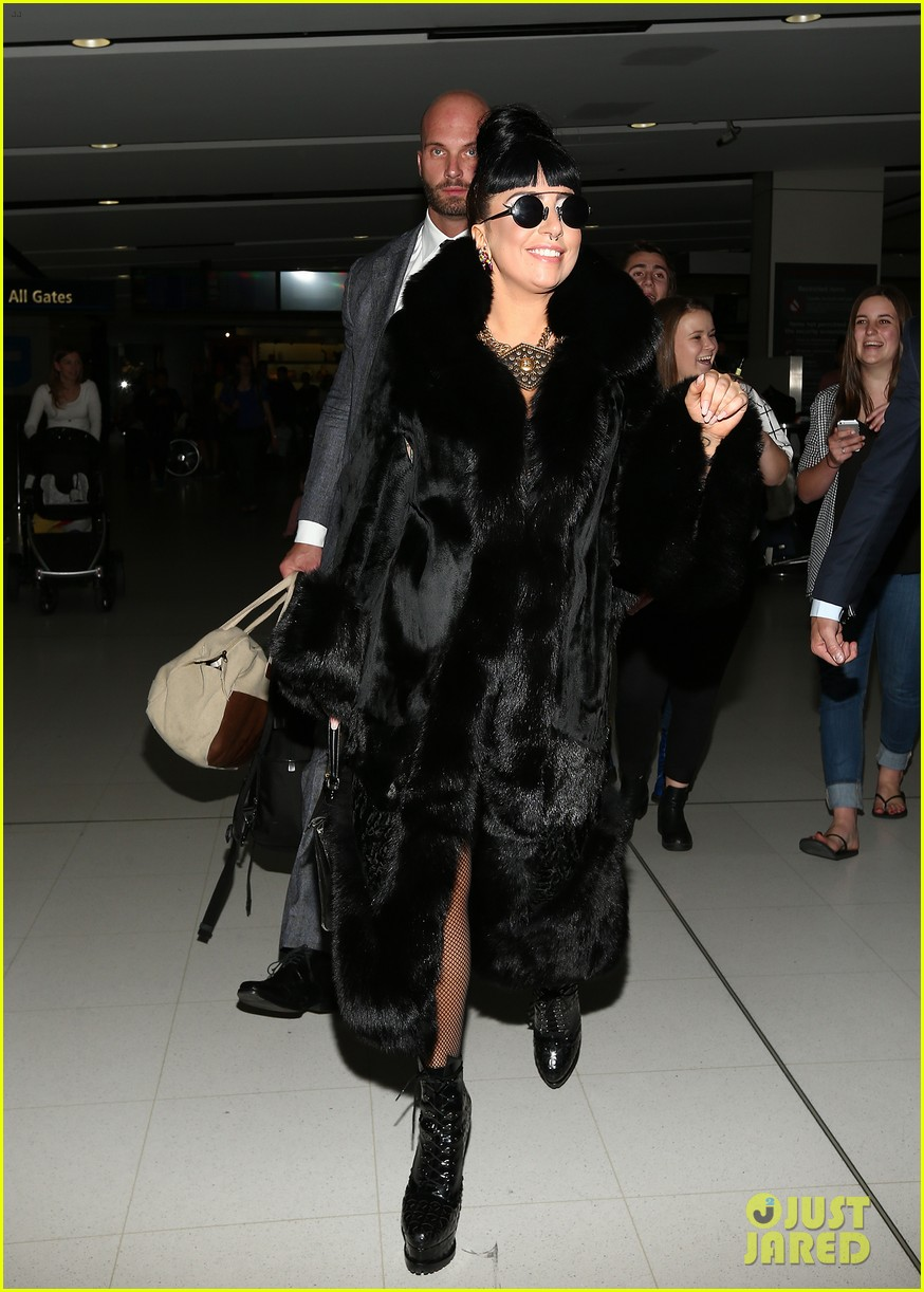 lady gaga reunites with pet pooch asia at lax airport 12