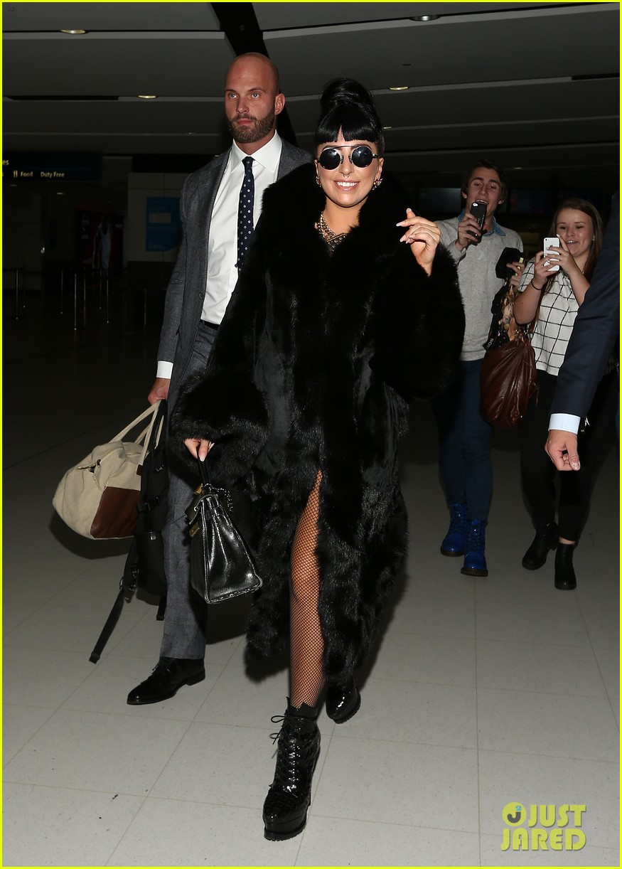 lady gaga reunites with pet pooch asia at lax airport 13
