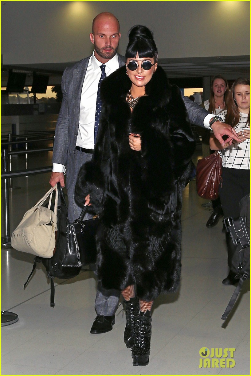 lady gaga reunites with pet pooch asia at lax airport 18