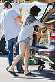 milla jovovich keeps her baby bump covered with baggy shirt 08