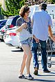 milla jovovich keeps her baby bump covered with baggy shirt 12