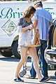 milla jovovich keeps her baby bump covered with baggy shirt 24
