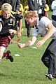 prince harry gets tackled by a young female during rugby match 04