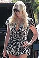 kesha shows cleavage in floral romper for china trip 04