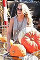 leann rimes lifts a huge pumpkin 08