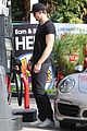 alexander skarsgard looks hot getting gas 01
