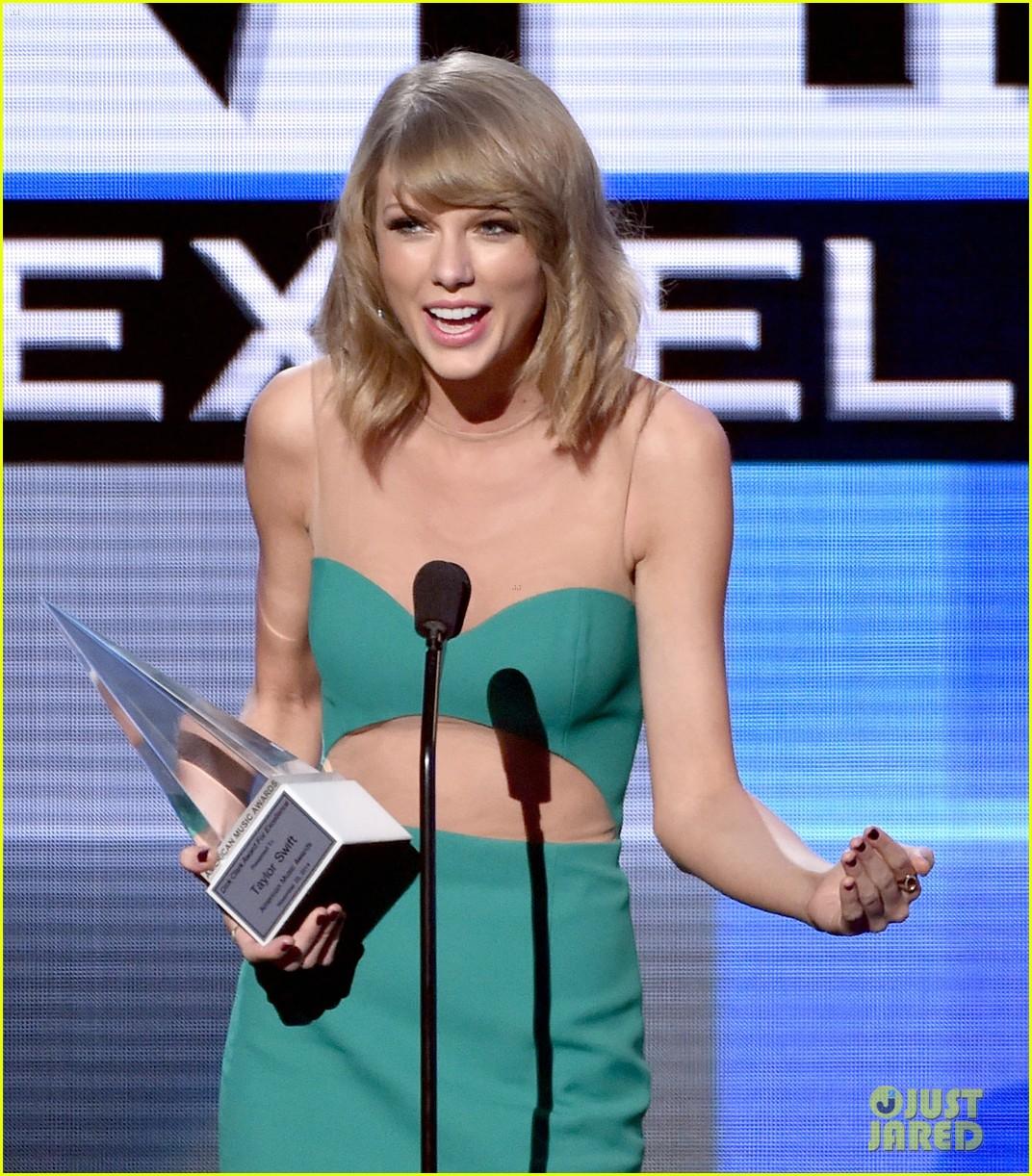 Taylor swift accepts dick clark award at amas 2014 video photo