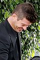 robin thicke takes young girlfriend to liquor store 03