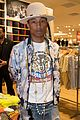 pharrell williams helps uniqlo host charity shopping event 08