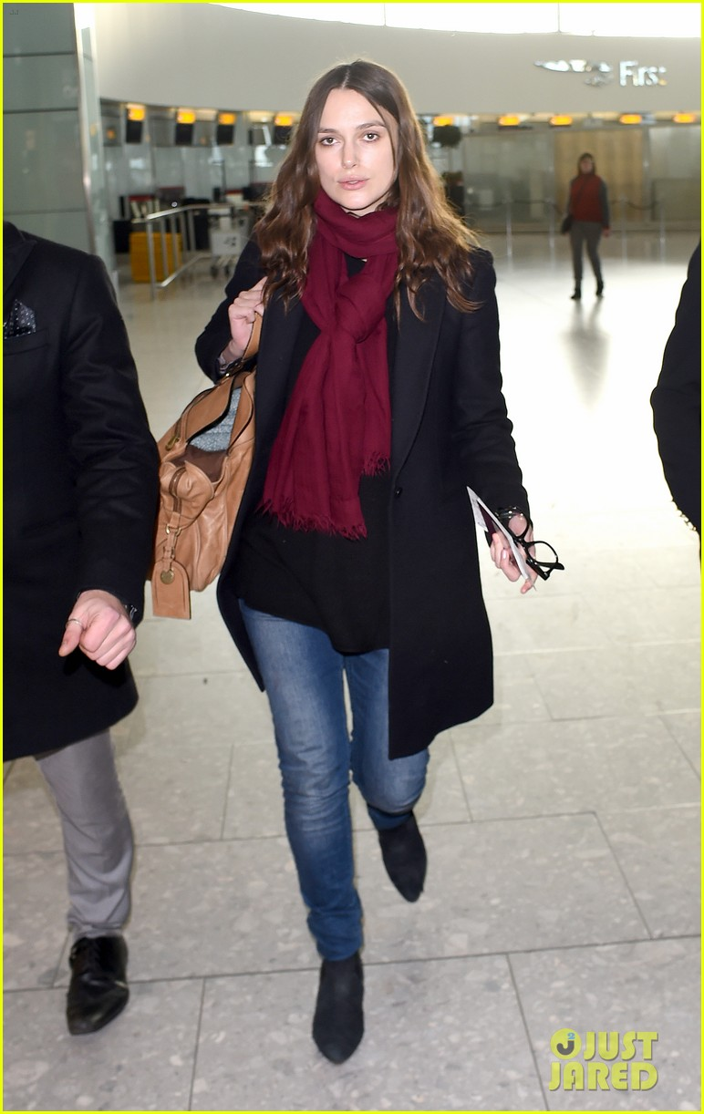 Keira knightley covers up her baby bump in first sighting since