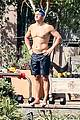 orlando bloom goes shirtless for outdoor swim weights workout 23