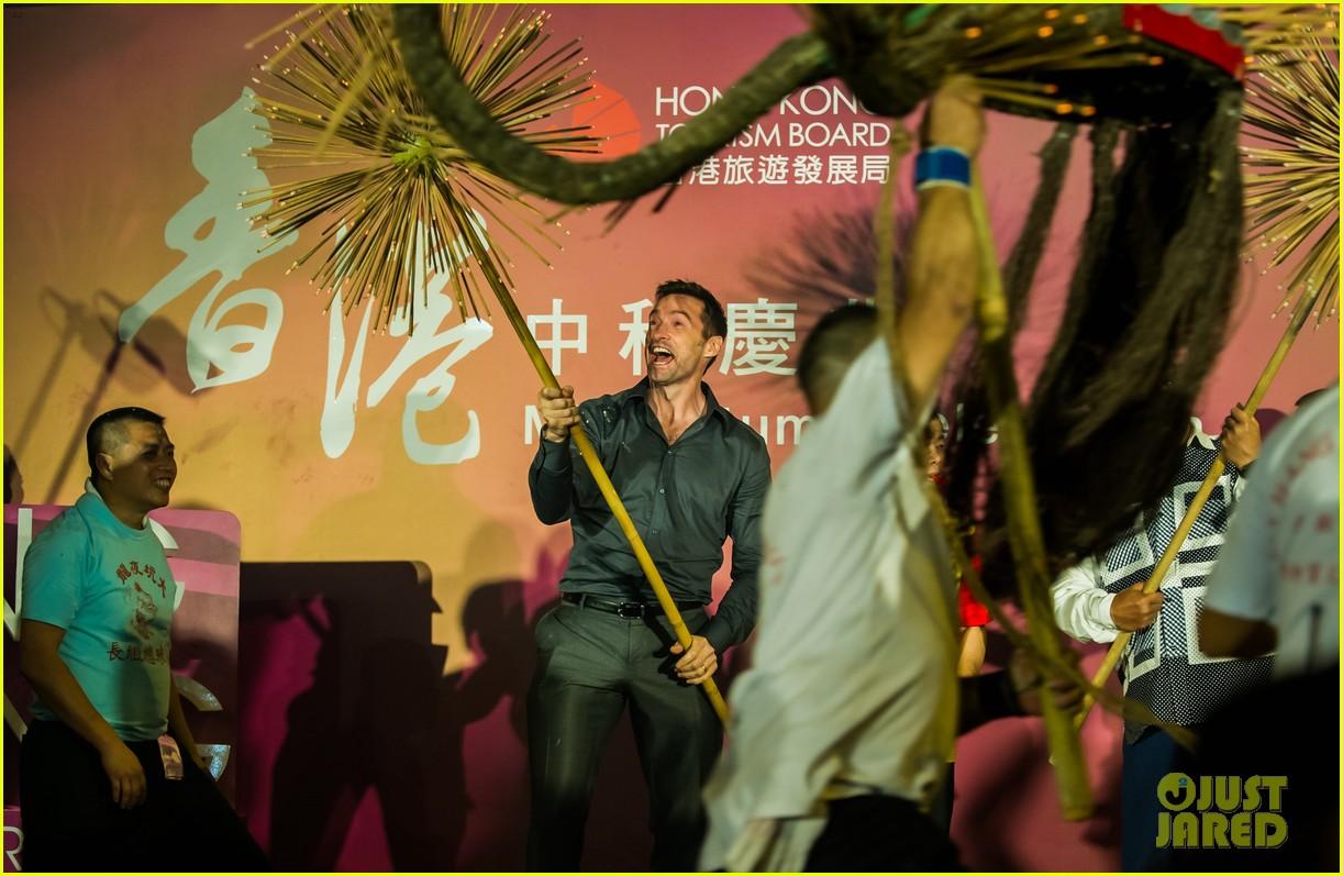 hugh jackman dances with the fire dragon in hong kong 163472722