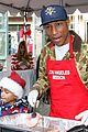 emmy rossum pharrell feed homeless christmas eve 28