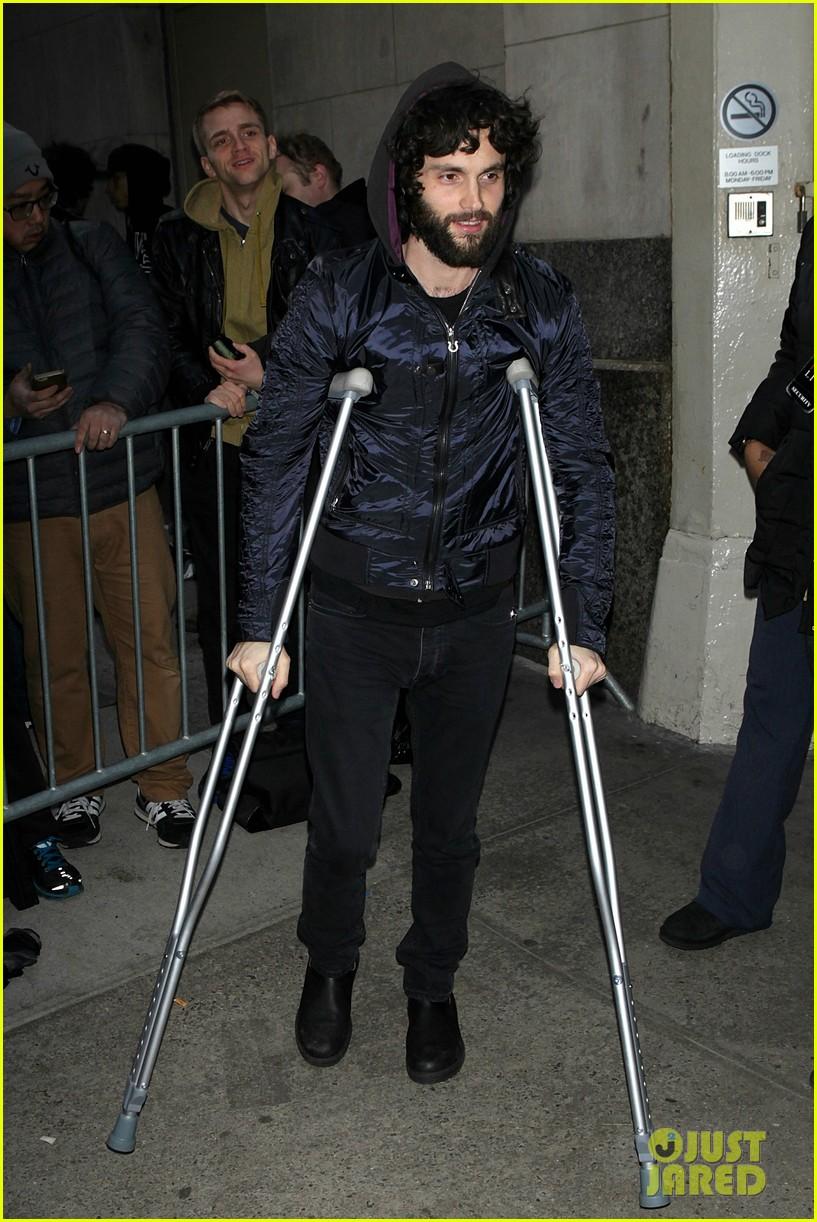 Penn Badgley Walks Around on Crutches in New York City