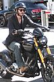 keanu reeves rides around on his moto 14