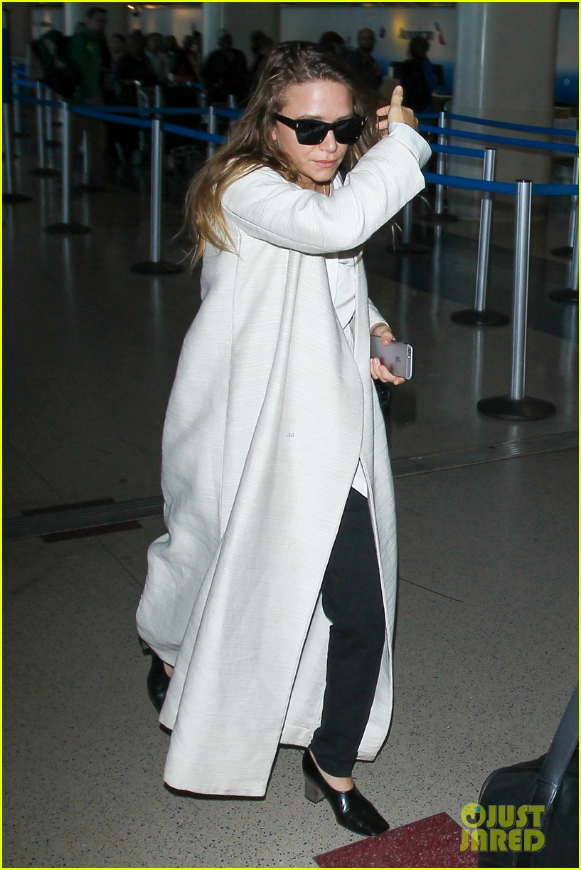 mary kate olsen lands at lax with husband olivier sarkozy photo