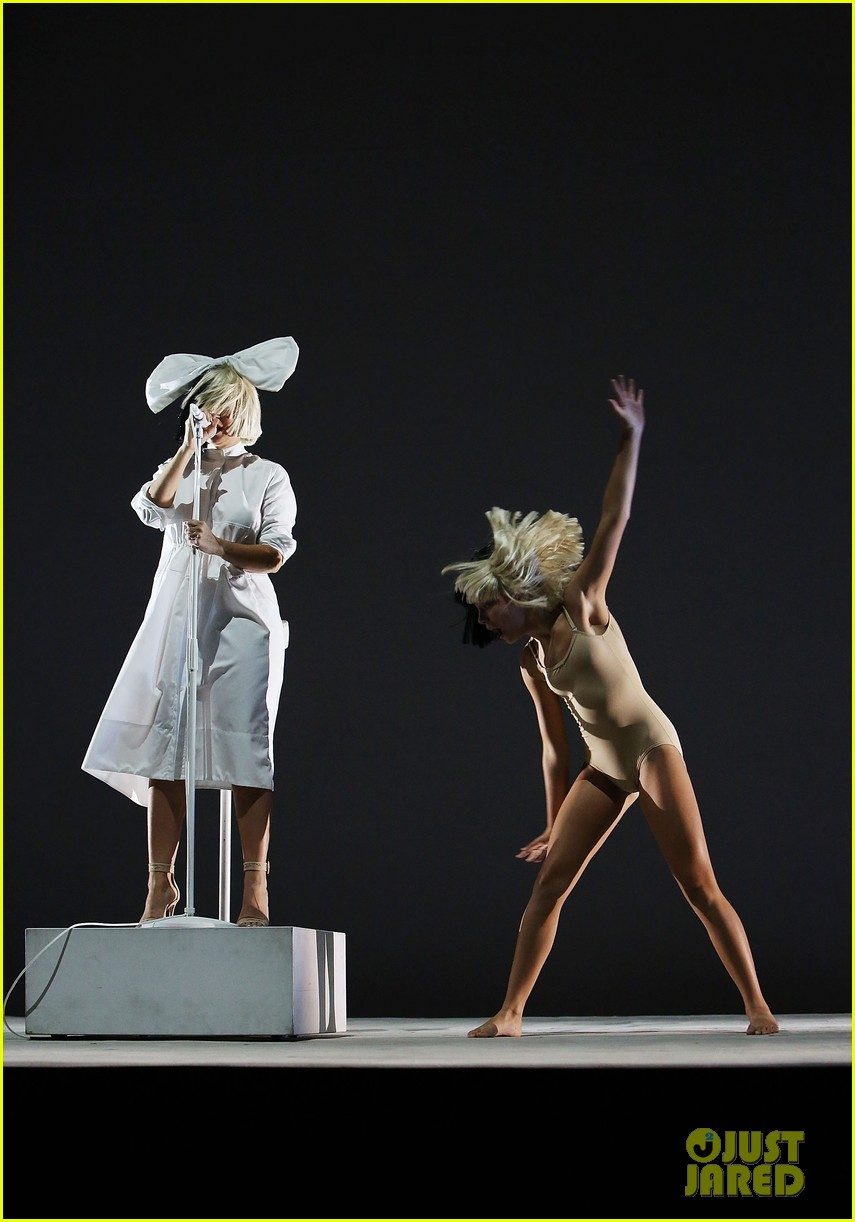 full sized photo of sia shows her face in concert 12