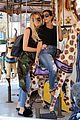kourtney khloe kardashian ride a merry go round together 19