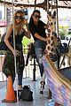 kourtney khloe kardashian ride a merry go round together 30