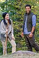jaimie alexander crawls around the woods while filming for blindspot 12