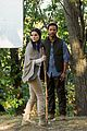 jaimie alexander crawls around the woods while filming for blindspot 14