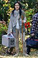 jaimie alexander crawls around the woods while filming for blindspot 26