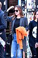 dakota johnson orange jacket soho walk 01