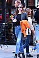 dakota johnson orange jacket soho walk 02