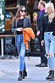 dakota johnson orange jacket soho walk 07