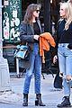 dakota johnson orange jacket soho walk 10