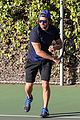 bradley cooper works on his serve on the tennis court 01