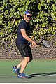 bradley cooper works on his serve on the tennis court 11