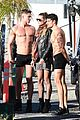 heidi klum surrounded by shirtless guys while filming gntm 03