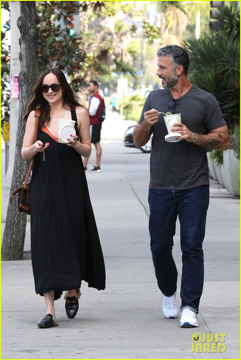 dakota johnson is all smiles alongside her personal trainer 013876542