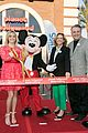 reese witherspoon attends grand opening of planet hollywood disney springs 03