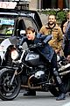 tom cruise fixes his hair after filming mission impossible 6 motorcycle scenes 03