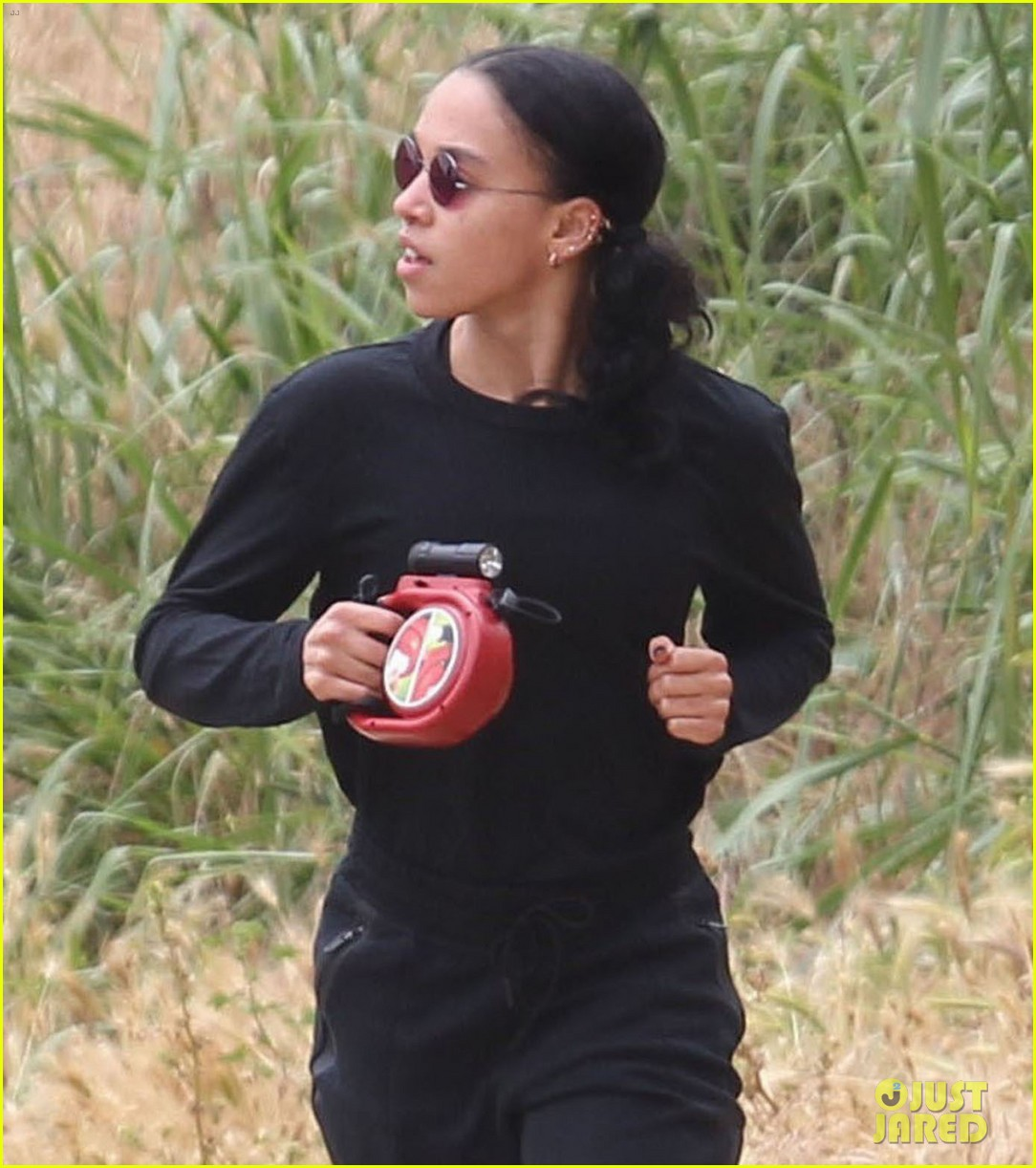 rob fka twigs take their dog for a hike033897143