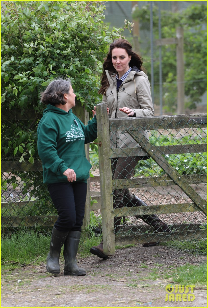 kate middleton feed baby lambs farms for children visit 133894793