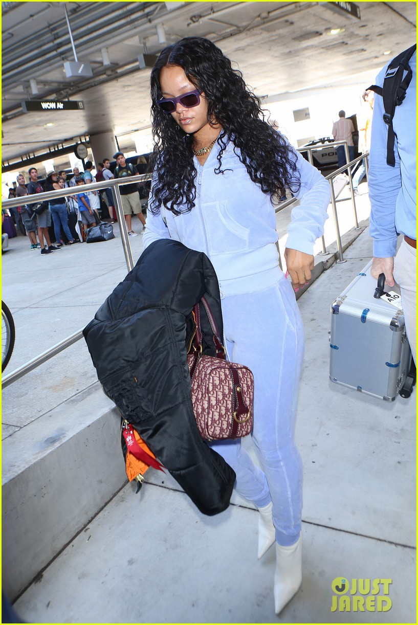 rihanna is pretty in purple velour tracksuit at lax airport 073919304