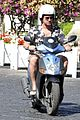 gerard butler suits up in ischia rides scooter around town 03