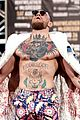 conor mcgregor goes shirtless during press conference with floyd mayweather jr 11